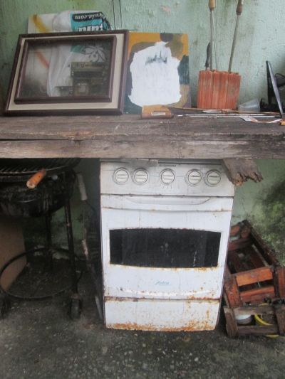 My old stove is now my work bench and garden storage