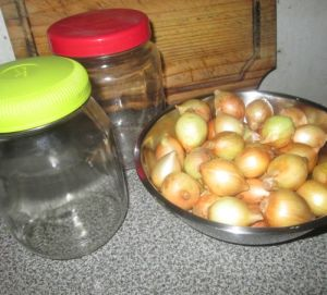 Onions and jars ready for pickling